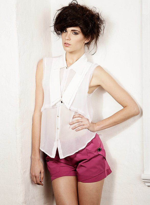 female studio shoot with white shirt and pink pants