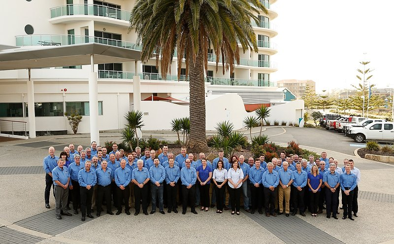 Large Group People Outdoors Blue Shirts Hotel